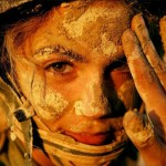 Israeli female soldier with mud